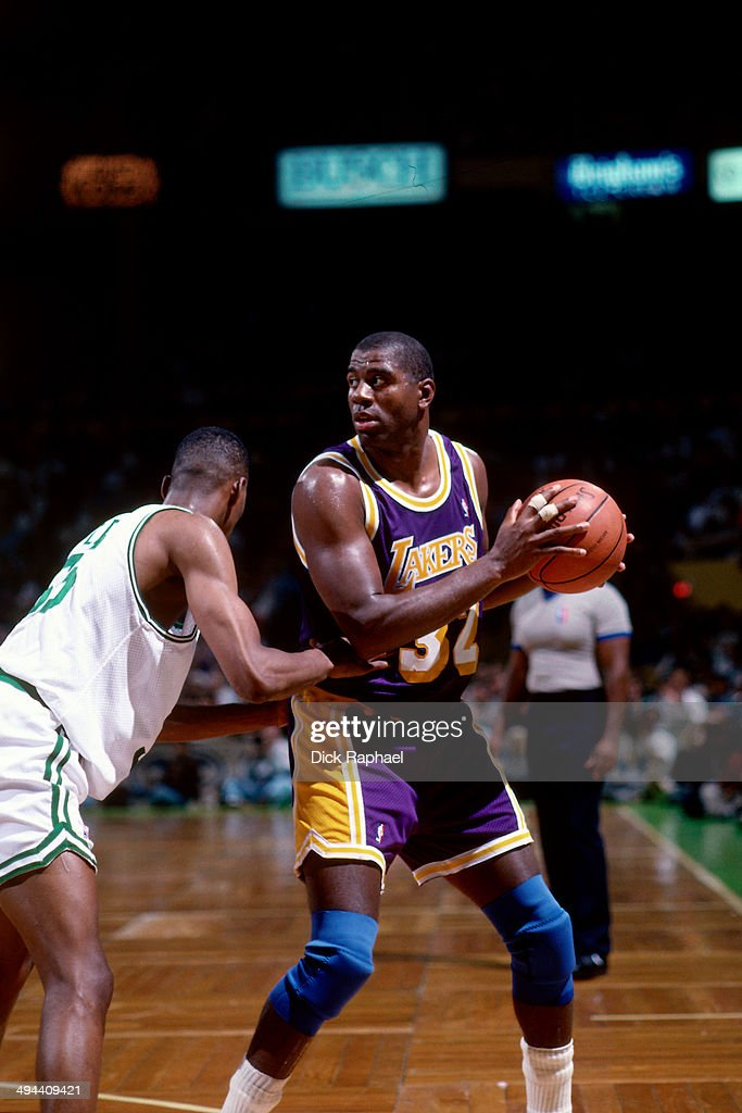 timeless design e531a a80b2 Magic Johnson of the Los Angeles Lakers handles the ball ...