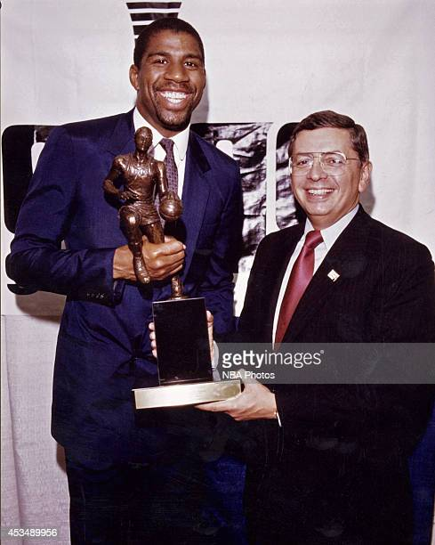 Magic Johnson of the Los Angeles Lakers is presented the 1987 MVP award by NBA Commissioner David Stern circa 1987 at the Great Western Forum in...