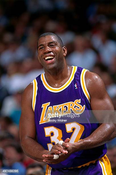 Magic Johnson of the Los Angeles Lakers laughs against the Sacramento Kings circa 1996 at Arco Arena in Sacramento California NOTE TO USER User...