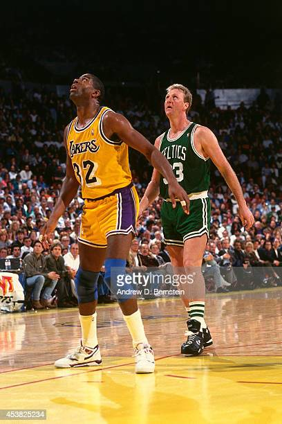 Magic Johnson of the Los Angeles Lakers looks on against Larry Bird of the Boston Celtics circa 1991 at the Great Western Forum in Inglewood...