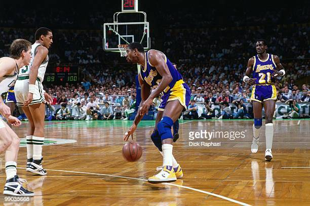 Magic Johnson of the Los Angeles Lakers looks to make a move against the Boston Celtics during the 1987 NBA Finals at the Boston Garden in Boston...