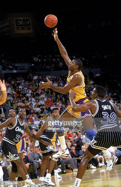 Magic Johnson of the Los Angeles Lakers makes a layup during a game against the Orlando Magic Mandatory Credit Stephen Dunn /Allsport