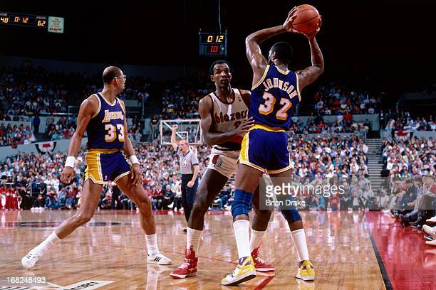 Magic Johnson of the Los Angeles Lakers passes against the Portland Trail Blazers during a game played circa 1987 at the Veterans Memorial Coliseum...