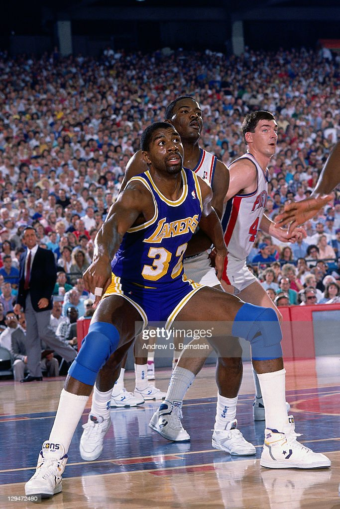 Magic Johnson of the Los Angeles Lakers posts up against ...