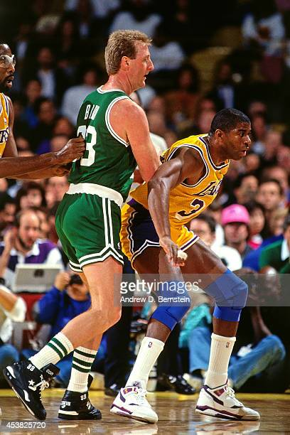 Magic Johnson of the Los Angeles Lakers posts up against Larry Bird of the Boston Celtics circa 1991 at the Great Western Forum in Inglewood...