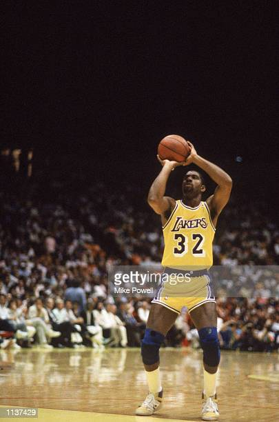 Magic Johnson of the Los Angeles Lakers shoots a free throw during an NBA Finals game against the Boston Celtics at the Great Western Forum in Los...