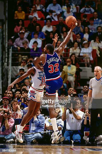 Magic Johnson of the Los Angeles Lakers shoots a sky hook against the Eastern Conference Team during the 1991 NBA AllStar game at the Charlotte...