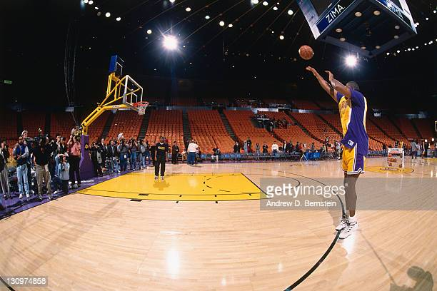 Magic Johnson of the Los Angeles Lakers shoots prior to a game against the Golden State Warriors on January 30 1996 at the Great Western Forum in...