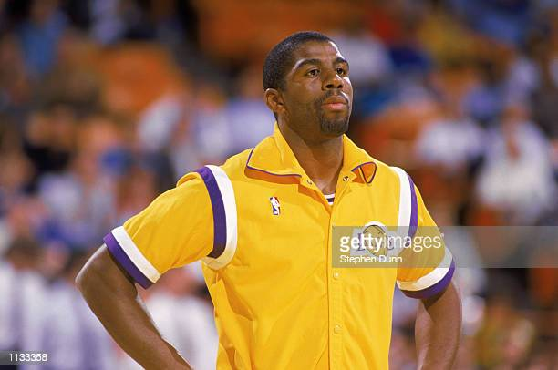 Magic Johnson of the Los Angeles Lakers stands during warm ups before an NBA game at the Great Western Forum in Los Angeles California in 1987