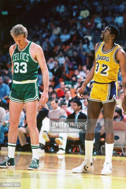 Magic Johnson of the Los Angeles Lakers stands next to Larry Bird of the Boston Celtics circa 1985 at the Great Western Forum in Inglewood California...