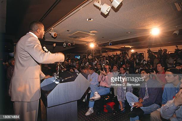 Magic Johnson of the Los Angeles Lakers talks to the media during a press conference to announce he was named the Los Angeles Lakers Head Coach on...