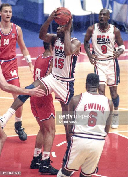 Magic Johnson of the United States drives to the basket in the men's basketball final against Croatia at the Barcelona Olympics in August 1992 with...