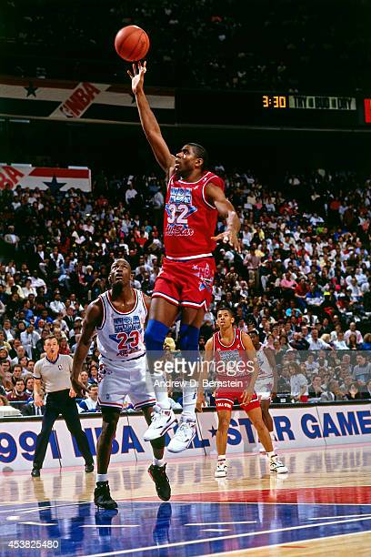 Magic Johnson of the West AllStars shoots during the 1991 NBA All Star Game on February 10 1991 at the Charlotte Coliseum in Charlotte North Carolina...