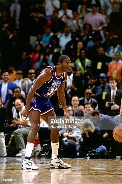 Magic Johnson of the Western Conference AllStars defends against the Eastern Conference AllStars during the 1992 NBA AllStar Game on February 9 1992...