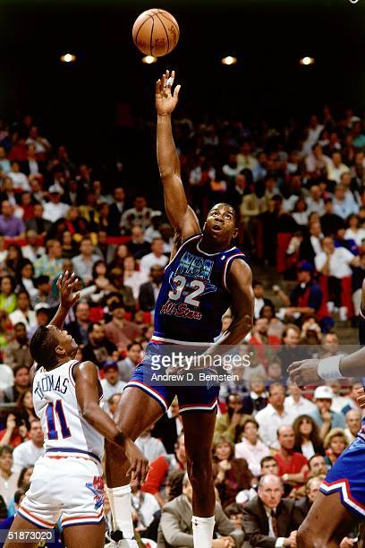 Magic Johnson of the Western Conference AllStars goes for a hook shot against the Eastern Conference AllStars during the 1991 NBA AllStar Game on...