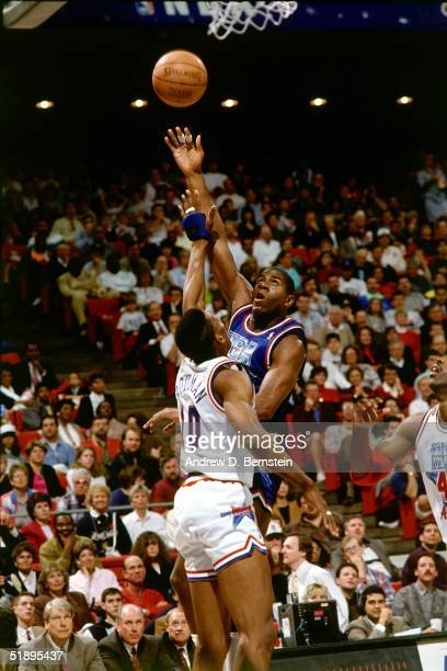 Magic Johnson of the Western Conference AllStars goes for a hookshot against Dennis Rodman of the Eastern Conference AllStars during the 1991 NBA...