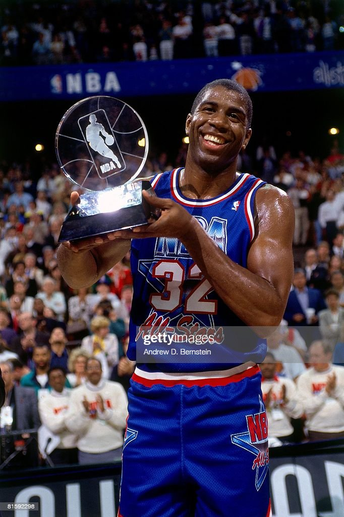 4dae4dd75698 1992 NBA All Star Game. ORLANDO- FEBRUARY 9  Magic Johnson  32 of the Western  Conference All-Stars holds the MVP trophy following ...