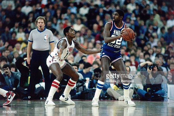 Magic Johnson of the Western Conference AllStars looks to pass against the Isiah Thomas of the Eastern Conference AllStars during the 1985 NBA...