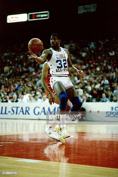 Magic Johnson of the Western Conference AllStars makes a pass against the Eastern Conference AllStars during the 1983 NBA AllStar Game on February 13...
