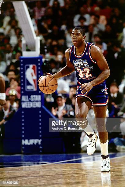 Magic Johnson of the Western Conference AllStars moves the ball upcourt against the Eastern Conference AllStars during the 1992 NBA AllStar Game on...