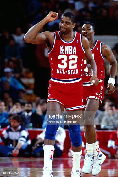 Magic Johnson of the Western Conference AllStars pumps his fist during the 1988 NBA AllStar Game on February 7 1988 at Chicago Stadium in Chicago...