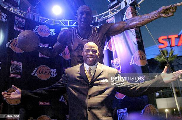 Magic Johnson poses in front of 14foot statute of himself during unveiling ceremony at the Staples Center on Wednesday Feb 11 2004