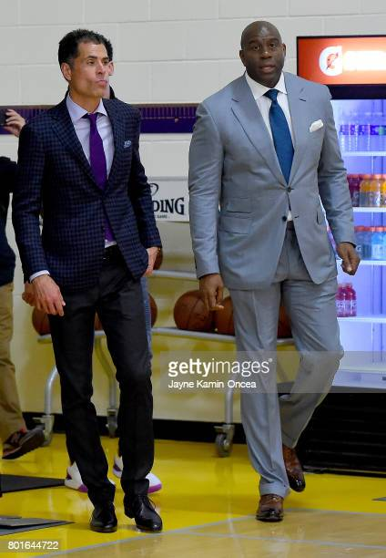 Magic Johnson president of basketball operations and Rob Pelinka general manager of the Los Angeles Lakers arrive for a press conference on June 23...