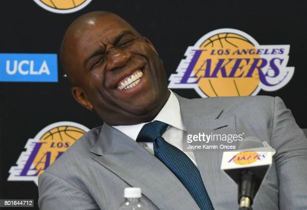 Magic Johnson president of basketball operations of the Los Angeles Lakers shares a laugh with the media during a press conference on June 23 2017 at...