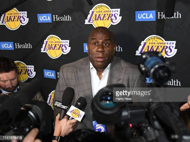Magic Johnson reacts as he speaks to the press resigning as Los Angeles Lakers President of Basketball Operations before the game against the...