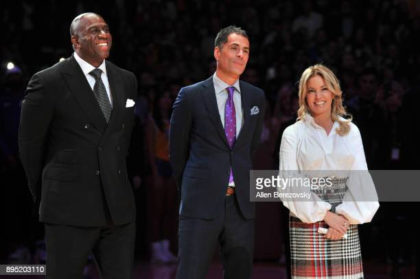 Magic Johnson Rob Pelinka and Jeanie Buss attend Kobe Bryant's jersey retirement ceremony during a basketball game between the Los Angeles Lakers and...