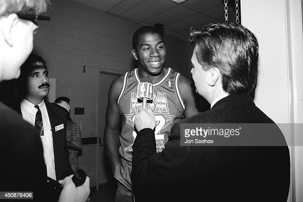 Magic Johnson smiles talks to reporters after the 1992 NBA AllStar Game at Orlando Arena on February 9 1992 in Orlando Florida NOTE TO USER User...