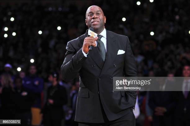 Magic Johnson speaks at Kobe Bryant's jersey retirement ceremony during halftime of a basketball game between the Los Angeles Lakers and the Golden...