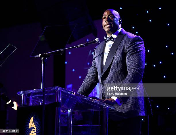 Magic Johnson speaks onstage at the Pre-GRAMMY Gala and Salute To Industry Icons honoring Martin Bandier at The Beverly Hilton Hotel on February 7,...