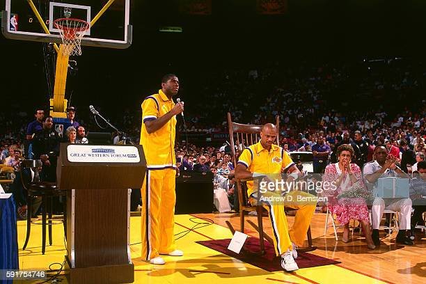 Magic Johnson speaks while Kareem AbdulJabbar of the Los Angeles Lakers sits in a big rocking chair before his last game against the Seattle...