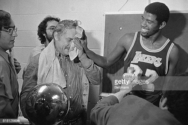 Magic Johnson wipes the face of Lakers' owner Dr Jerry Buss after he poured champagne over him after the Lakers beat the Sixers 123107 to win here...