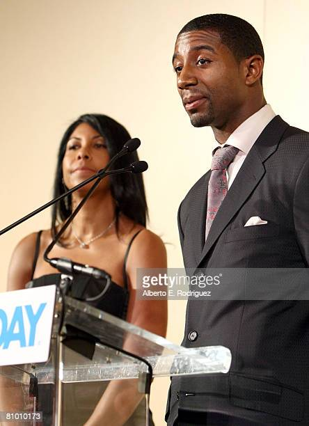 Magic Johnson's son Andre Johnson speaks as Cookie Johnson looks on during the USA TODAY Hollywood Hero honoring Magic Johnson at the Beverly Hills...