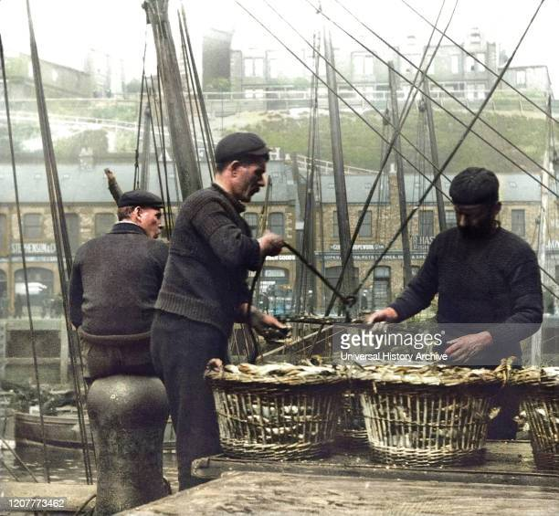 Magic lantern slide circa 1880., Victorian/Edwardian Social History. A picture of fishermen unloading herring at North Shields Fish Quay; North...
