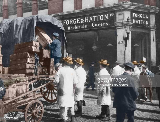 Magic lantern slide circa 1880, Victorian/Edwardian Social History. Forge and Hatton Limited, Billingsgate Market London. Loading fish onto horse and...