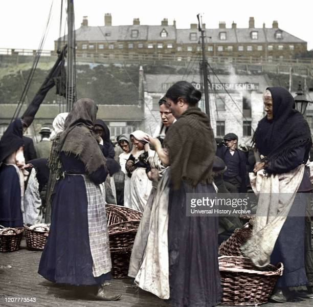 Magic Lantern Slide circa 1880, Victorian/Edwardian Social History. Fish women at North Shields Fish Quay with baskets of herring; North Shields,...