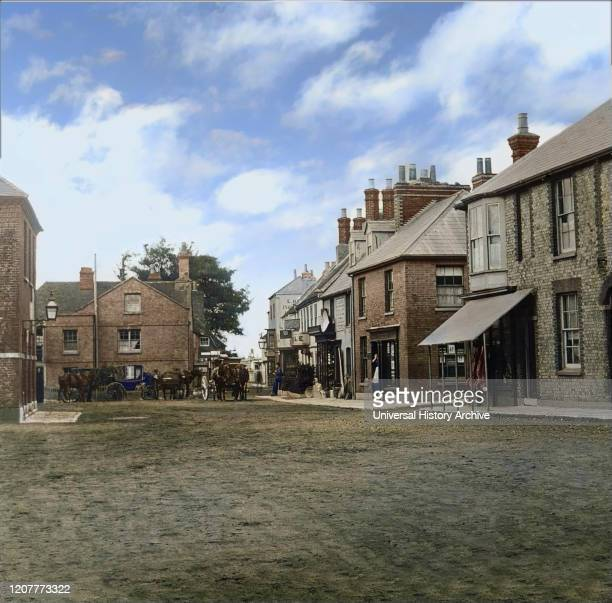 Magic lantern slide circa 1880, Victorian/Edwardian Social History. Market Square and Coaching Inn with horses and coaches outside; Yarmouth, Isle of...
