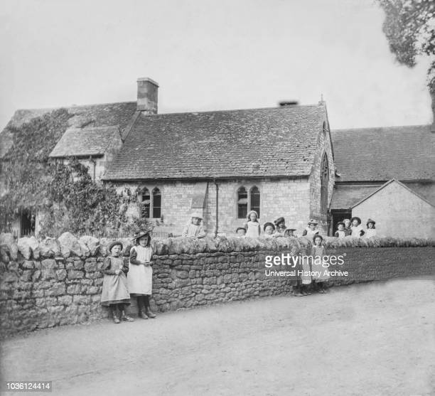 Magic lantern slide circa 1900.Victorian. Victorian children outside the school and in the lane. Uffington school referred to in Tom Brown's School...