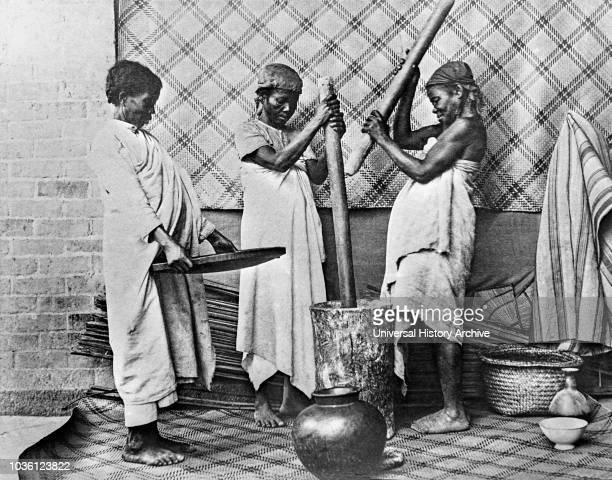 Magic lantern slide circa 1900VictorianSocial History Hova Women pounding rice Madagascar Slide from SPG the society for the propogation of the...