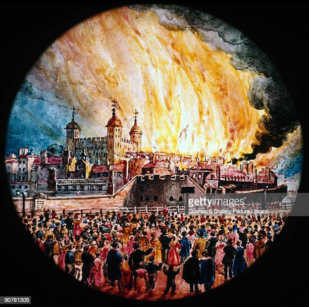 Magic lantern slide showing the Great Fire of London raging watched by a huge crowd of people Although the fire reached the gates the Tower survived...