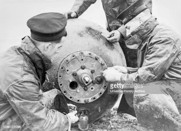 Magic lantern slide WW2 19391946 World war two images A trainign crew of sailors from HMS Victory disarming a mine The fuse has been removed