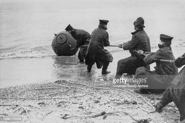 Magic lantern slide WW2 19391946 World war two images Training sailors from HMS Victory in Portsmouthdragging a mine ashore to defuse 5 Cadets with a...
