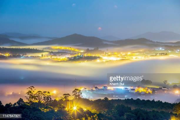 magic light and dense fog of the city at night