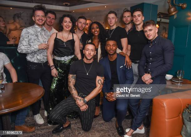 Magic Mike cast members pose with Alexandra Burke and Samantha Baines at celebrations for Magic Mike Live's first birthday in the West End at...