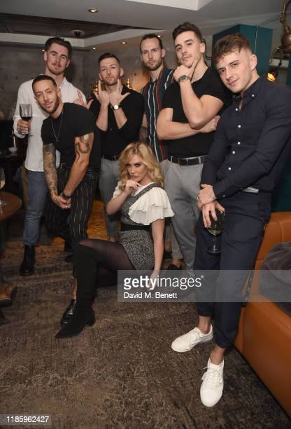Magic Mike cast members pose with Camilla Kerslake at celebrations for Magic Mike Live's first birthday in the West End at Hippodrome Casino on...