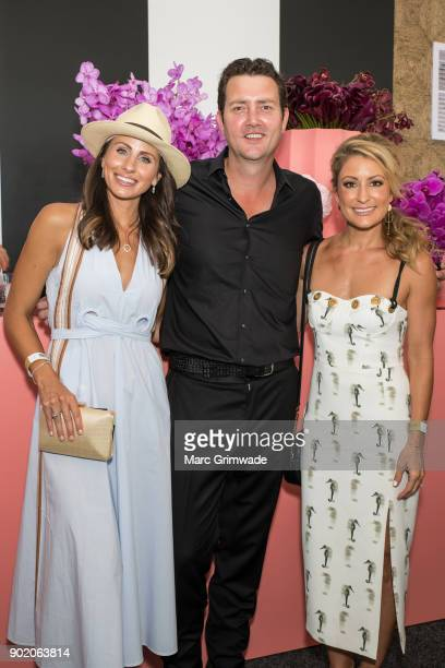 Magic Millions ambassador Amanda Abate and singer Adam Harvey and Liz Cantor attends Magic Millions Polo on January 7 2018 in Gold Coast Australia