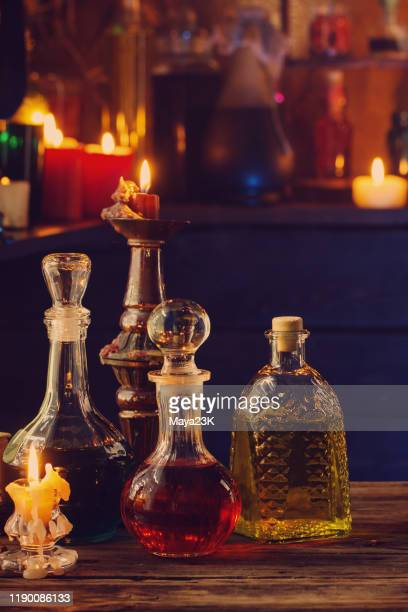 magic potions bottles wooden background